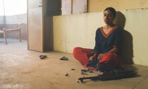 Film still from My Pure Land showing Nazo with the stolen bullets.