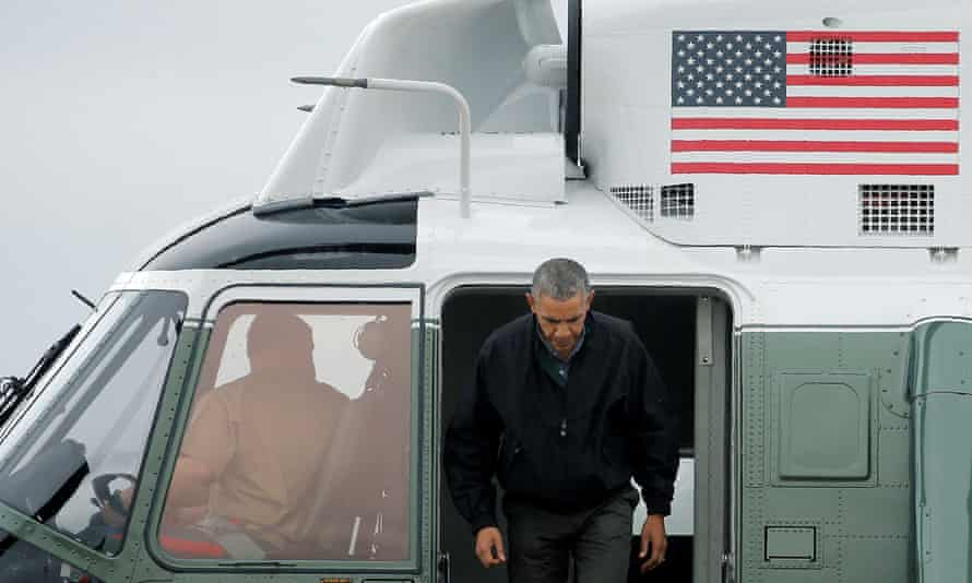 Barack Obama arrives to board Air Force One for travel to Vietnam and Japan.