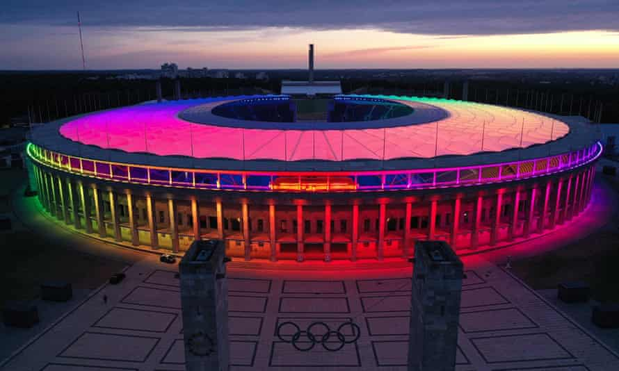 Berlin's Olympiastadion is lit up in rainbow colours in solidarity after a similar display in Munich was blocked by Uefa.