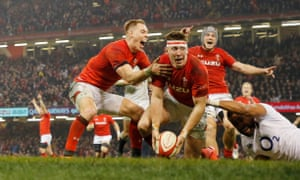 Josh Adams scores the second Welsh try during the Wales v England Six Nations international rugby union match at the Principality Stadium in Cardiff.