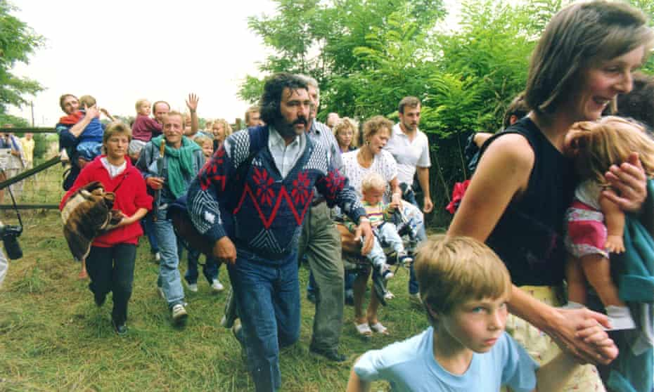 East Germans cross the Hungarian border into Austria, 19 August 1989.