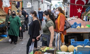 People wearing face masks walk in the Bazaar Beverwijk market, in Beverwijk, the Netherlands, after parts of the Bazaar have been closed by the Kennemerland safety region.