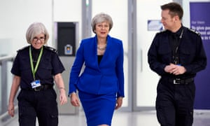 Theresa May with UK Border Force officials at Heathrow airport, December 2018