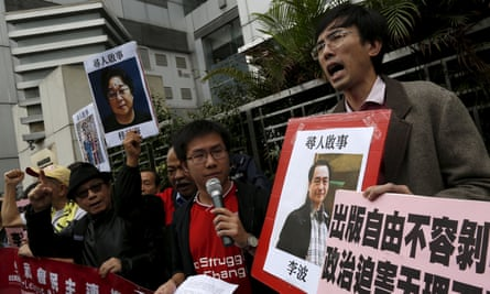 Demonstrators holding portraits of Lee Bo call for an investigation into the disappearance of five members of a Hong Kong publishing house and bookstore.