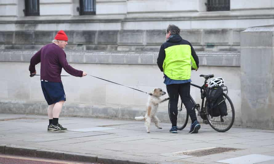 Boris Johnson out with his dog, and a passerby