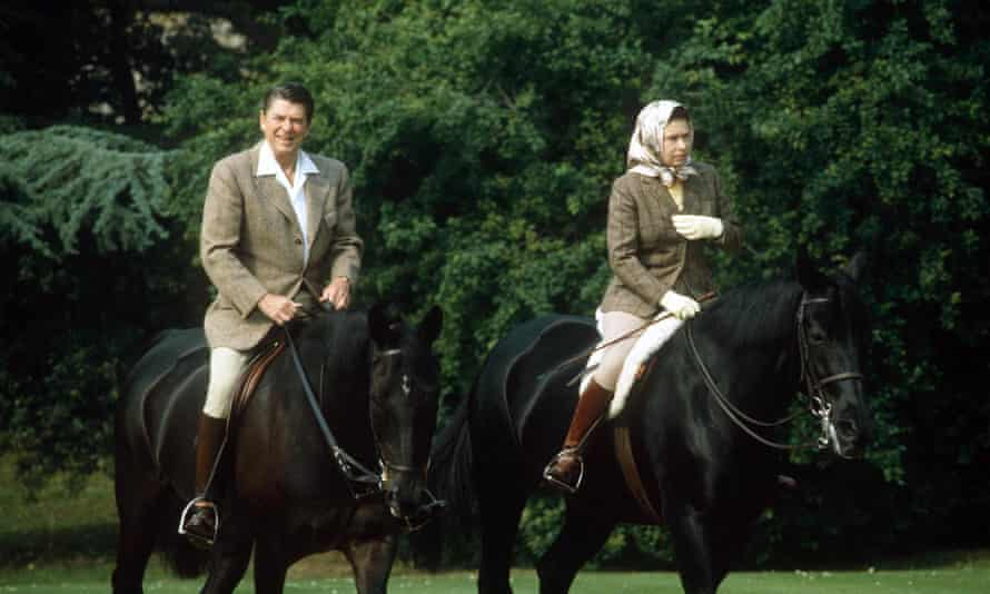 The Queen passes through Windsor Home Park with Ronald Reagan in 1982.