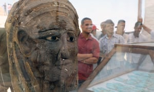 A gilded silver mask at the dig site near the Saqqara necropolis, Egypt