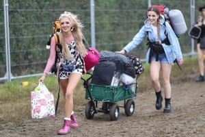 Festivalgoers head to the camping area to set up their tents on the first day of the Glastonbury festival