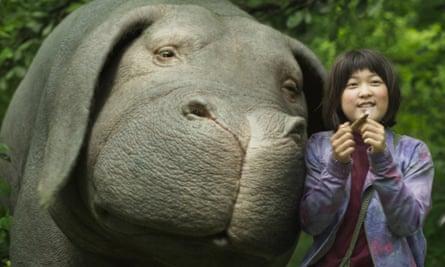 An Seo Hyun as Mija with her 'super-piglet' friend Okja.
