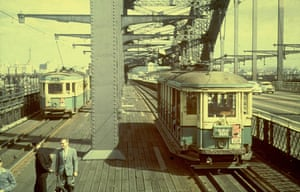 Two trams meet in the middle of the Sydney Harbour Bridge