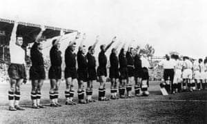 The Italian team, in all-black, give the fascist salute before their quarter-final against France at the 1938 World Cup.