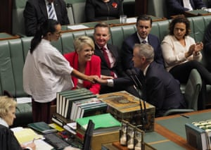 Linda Burney shakes hands with opposition leader Bill Shorten after he presented his reply to the prime minister Scott Morrison's Closing the Gap report