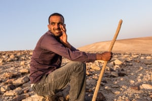 Awdeh rests while minding his sheep, about 3km from his village