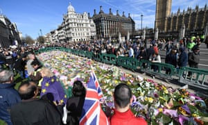 Floral tributes to the victims of the London terror attack on 22 March in Parliament Square.