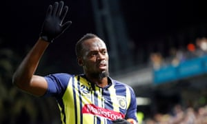 Usain Bolt waves to fans after playing for Central Coast Mariners