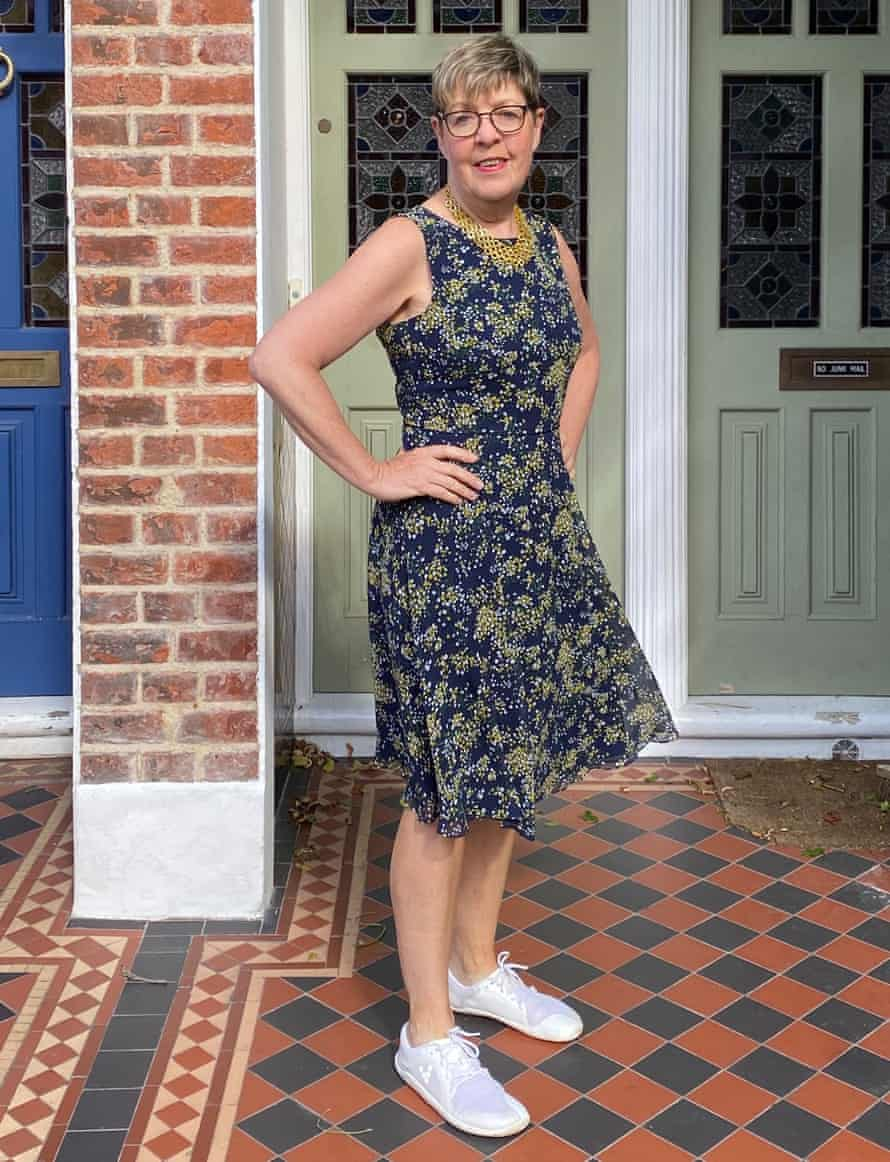 Elizabeth, ready to party in her sleeveless floral dress and white sneakers.
