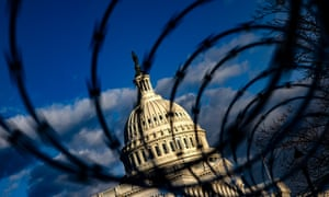 Razor wire still tops a seven foot fence that remains in place around the US Capitol building today.