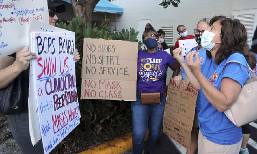 Teachers try to persuade anti-mask protester outside a Broward county school board meeting that all students need to wear masks to protect the most vulnerable.