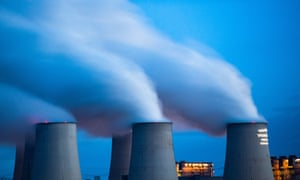 Smoke and vapour rising from the cooling towers and chimneys of the lignite-fired Jänschwalde power plant in eastern Germany.
