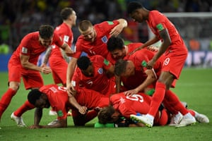 The England players celebrate winning the penalty shootout.