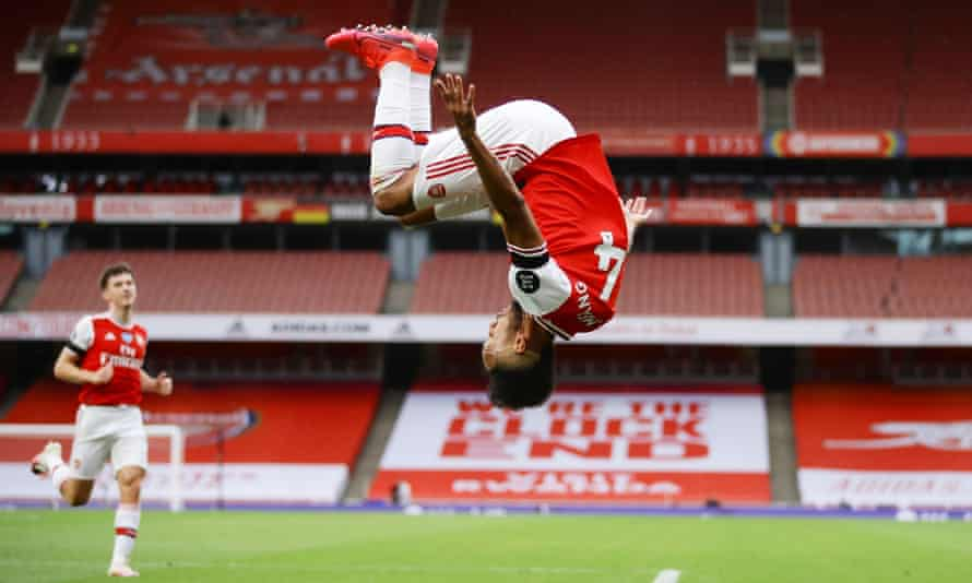 Arsenal's Pierre-Emerick Aubameyang celebrates with a somersault after scoring their third goal