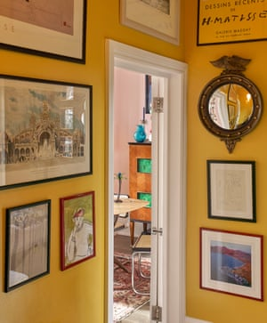 Bright yellow walls in the hall of the London home of interior designers and artists Luke Edward Hall and Duncan Campbell