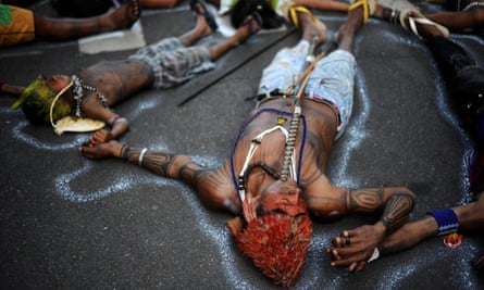 Munduruku people demonstrate in front of the Brazilian Ministry of Mines and Energy, calling for the suspension of construction of the Belo Monte hydroelectric plant.