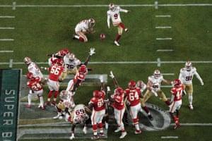 San Francisco 49ers' Robbie Gould kicks a field goal as Mitch Wishnowsky holds.