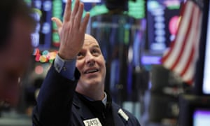 Trader John O'Hara on the floor of the New York Stock Exchange on Wednesday 26 December. The Dow closed up more than 1,000 points in best day for Wall Street in 10 years