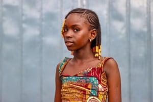 Conakry, Guinea: a child poses for a photo