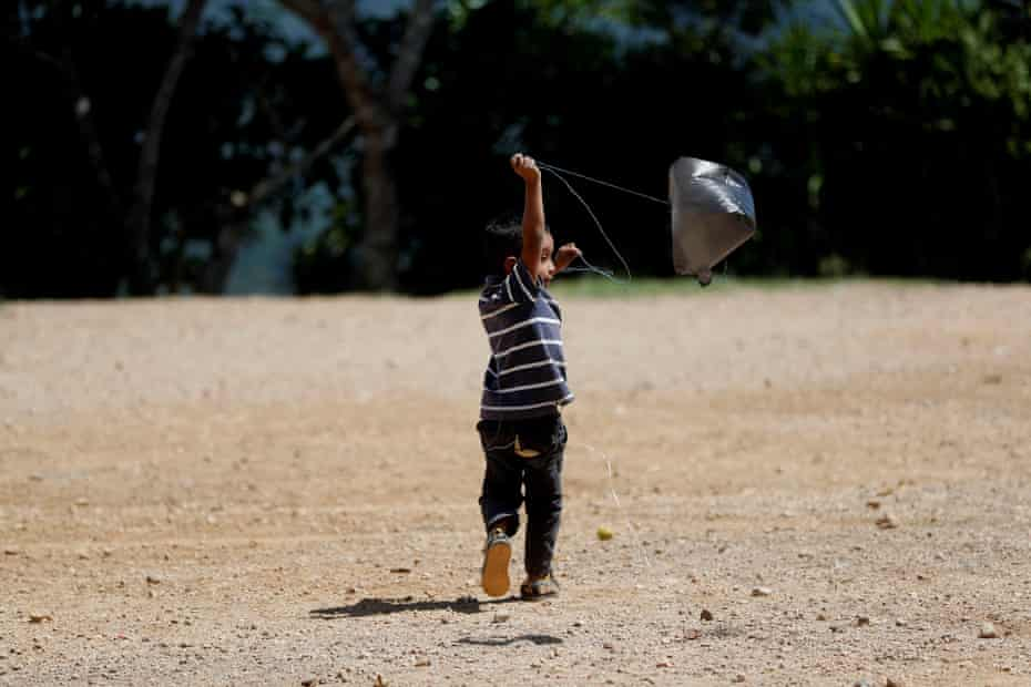 A child plays with a plastic bag in the Corredor Seco of Guatemala 25 October 2019, where the drought causes dozens of cases of child malnutrition.