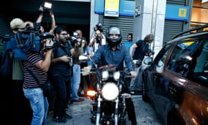 On his bike: Yanis Varoufakis leaves the finance ministry in Athens.