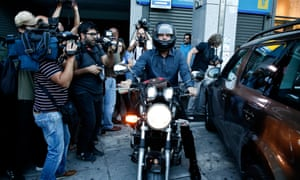 Yanis Varoufakis leaves the Athens finance ministry by motorbike in 2015.