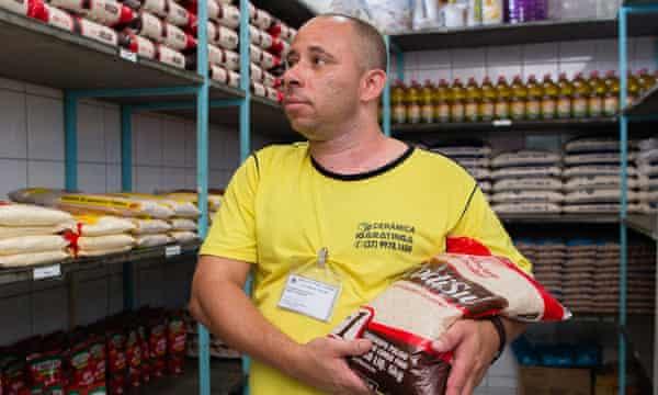 Rodrigo de Oliveiro Pinto looks after the storeroom at the men's prison in Itaúna.