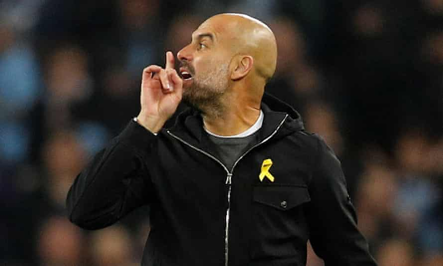 pep guardiola gestures to antonio mateu lahoz at half-time of the 2018 champions league game at home to liverpool. manchester city's manager was sent to the stand for the second half.
