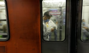 A man wears a surgical mask while riding the subway in Mexico City.