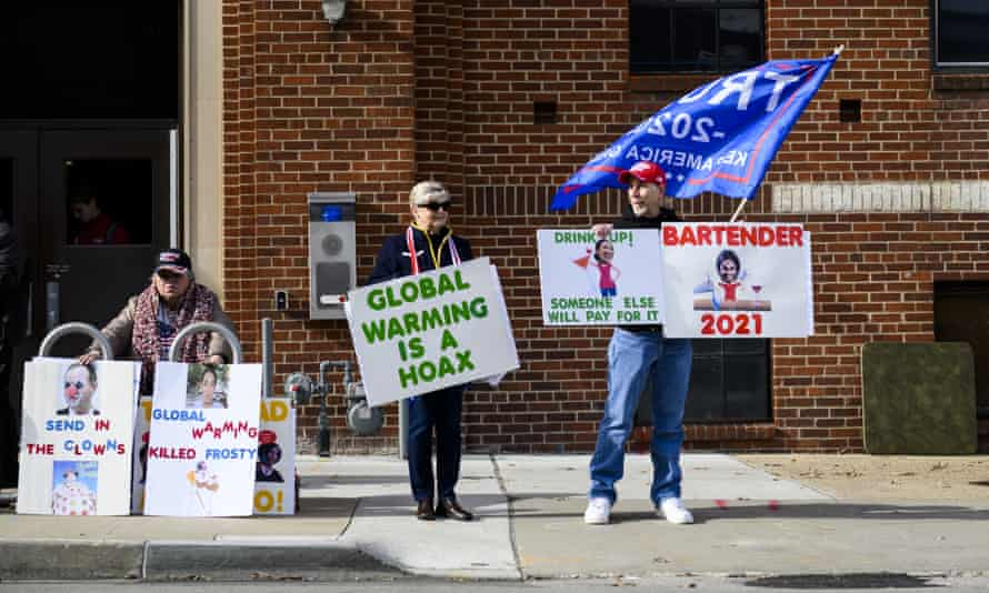 Donald Trump supporters protest a climate crisis summit in Des Moines, Iowa, in 2019.
