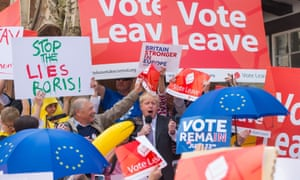 Boris Johnson is surrounded by Vote Leave and Vote Remain activists.