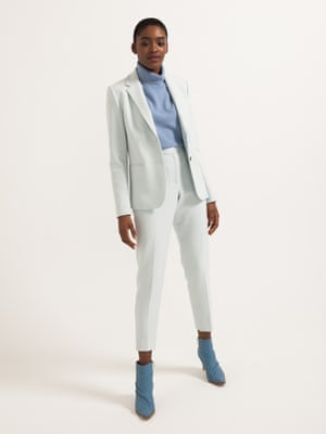 model wears polo neck, £89, marksandspencer.com. Blazer, £140, and trousers, £80, both frenchconnection.com. Boots, from a selection, tibi.com.