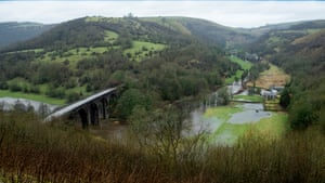 The fields are flooded at a farm on the bank of the River Wye in the Monsal valley