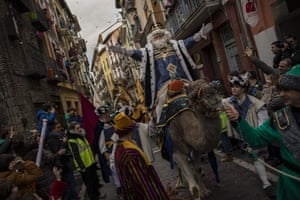 The Cabalgata Los Reyes Magos cross a street in Pamplona