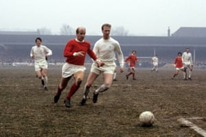 The Charlton brothers do battle on the pitch during a match between Manchester United and Leeds.