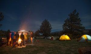 People around campsite fire, Smith Rock State Park, Oregon