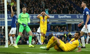 Jordan Pickford celebrates after saving a penalty kick from Crystal Palace Luka Milivojevic (bottom).