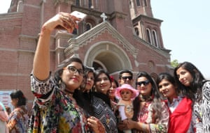 People in front of a church taking a selfie