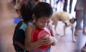 A child wait for a plate of food at a soup kitchen in Salta province, Argentina.