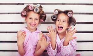 Children laugh and play in a beauty salon posed by models