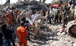 A search team removes a body from the collapsed building in Cambodia's Kep province