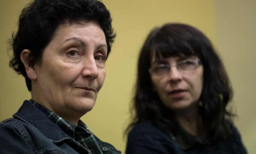 Activist sisters Elżbieta Wąs and Anna Gryta watch a town council meeting in Lubartów