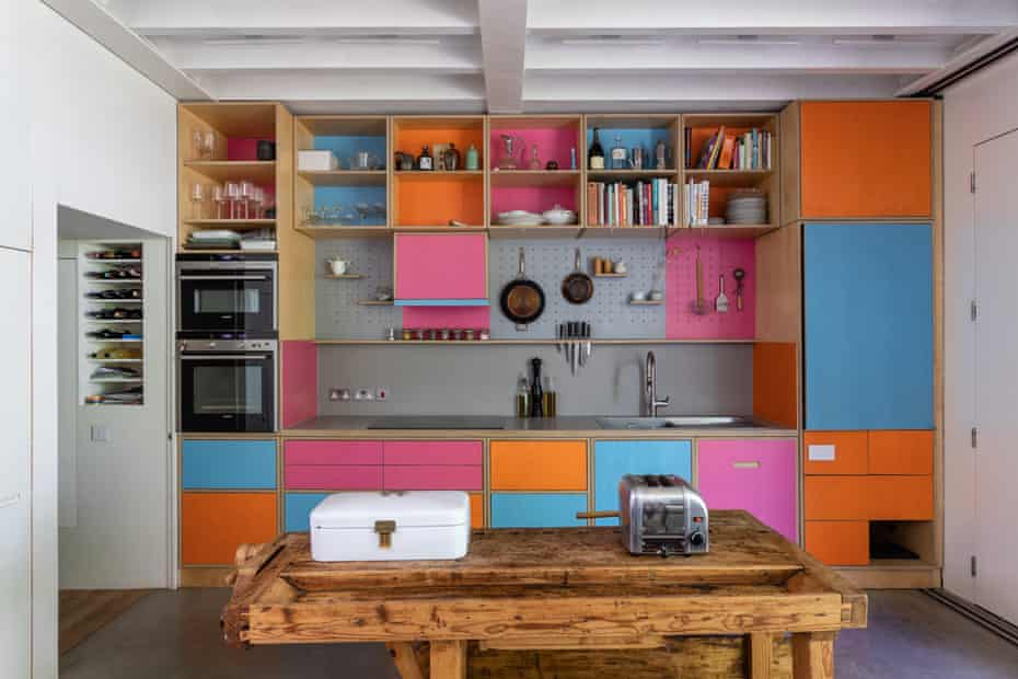 birch ply cupboards with orange, pink and blue-coloured fronts
